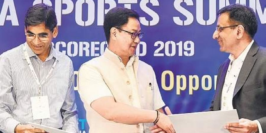 Sports Minister Kiren Rijiju (C) in New Delhi on Thursday.