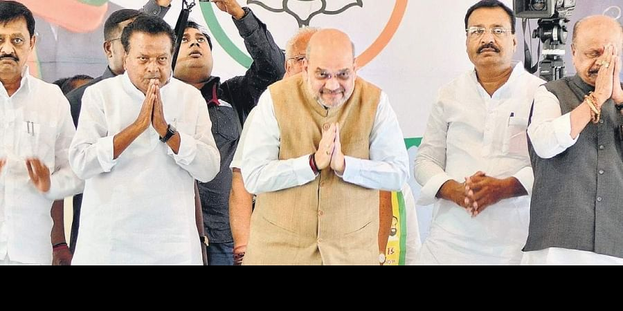 Home Minister Amit Shah greets his supporters during a rally ahead of Maharashtra's Assembly election, at Jat in Sangli district of Maharashtra on Thursday