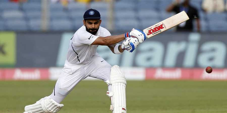 Virat Kohli bats during the second day of the second cricket Test match between India and South Africa in Pune.