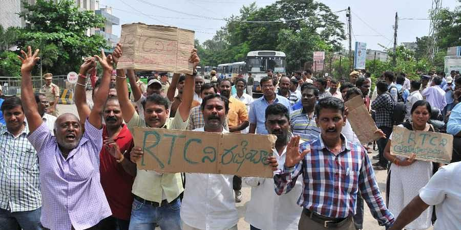 Members of TSRTC Unions demonstrated a protest on TSRTC Seventh day strike at JBS Bust station in Hyderabad on Friday.