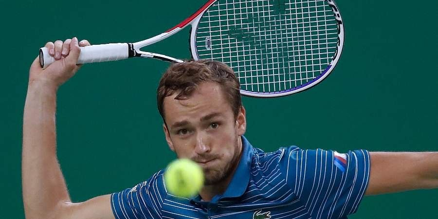 Daniil Medvedev eyes on the ball as he plays against Stefanos Tsitsipas in their men's singles semis match at the Shanghai Masters.