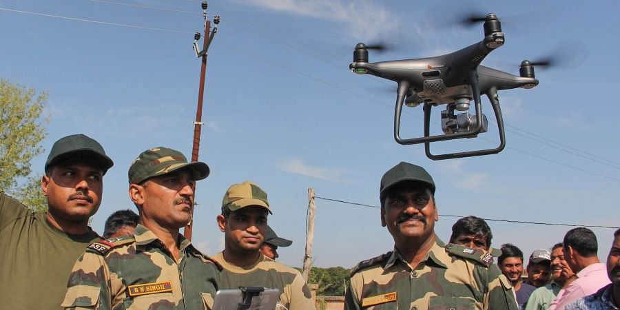 BSF officials explain the working of drone to the border area villagers at Gole Pattan village in Kanachak sector of Indo-Pak border about 25 kms from Jammu Saturday Oct. 5 2019.   (Photo   PTI)