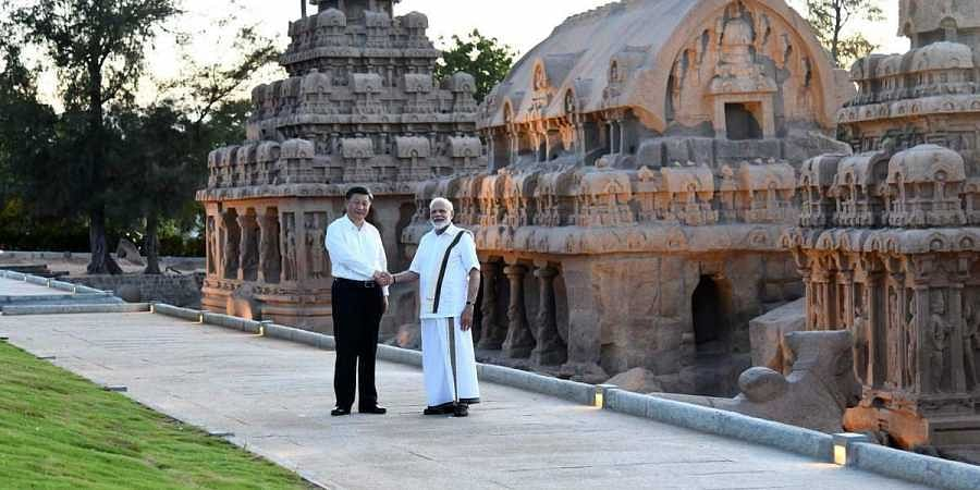 Prime Minister Narendra Modi and Chinese President Xi Jinping at the Pancha Rathas complex in Mamallapuram