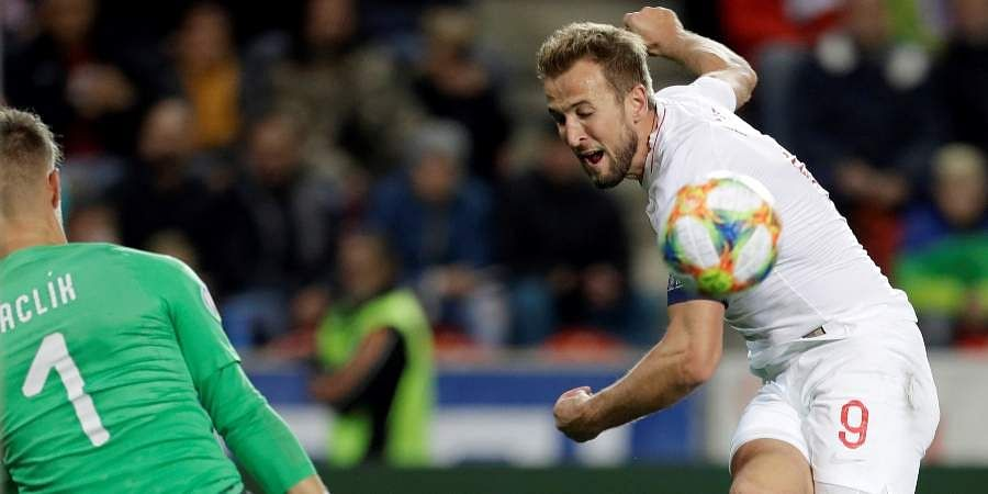 Czech Republic goalkeeper Tomas Vaclik, left, makes a save in front of England's Harry Kane during the Euro 2020 group A qualifying match at the Sinobo stadium in Prague.