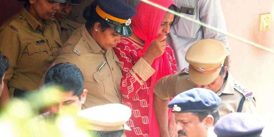 Police taking Prime accused Jollyamma to house of deceased Roy Thomas for collecting evidence at Koodathayi in Thamarassery.