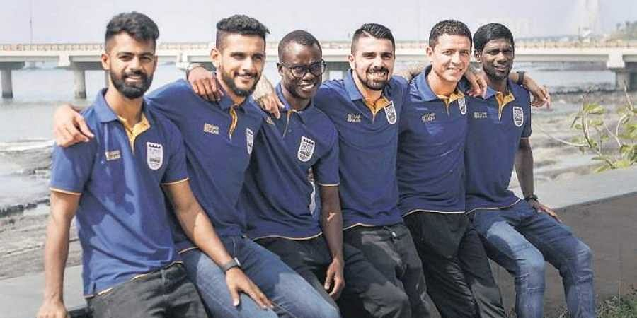 (from L) Mumbai's Mohammed Rafique, Pratik Chaudhari, Modou Sougou, Paulo Machado, Amine Chermiti & Rowllin Borges in Mumbai, on Friday