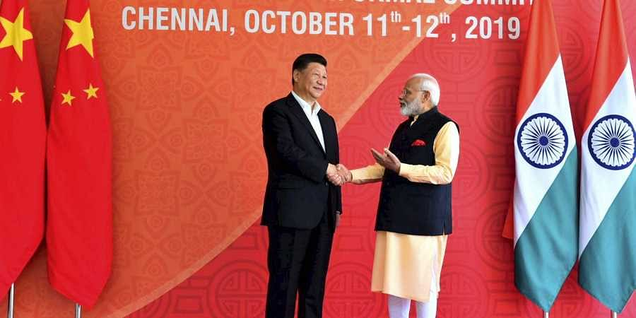 Prime Minister Narendra Modi with Chinese President Xi Jinping at Fisherman's Cove in Kovalam near Mamallapuram Saturday Oct. 12 2019. | (Photo | Twitter)