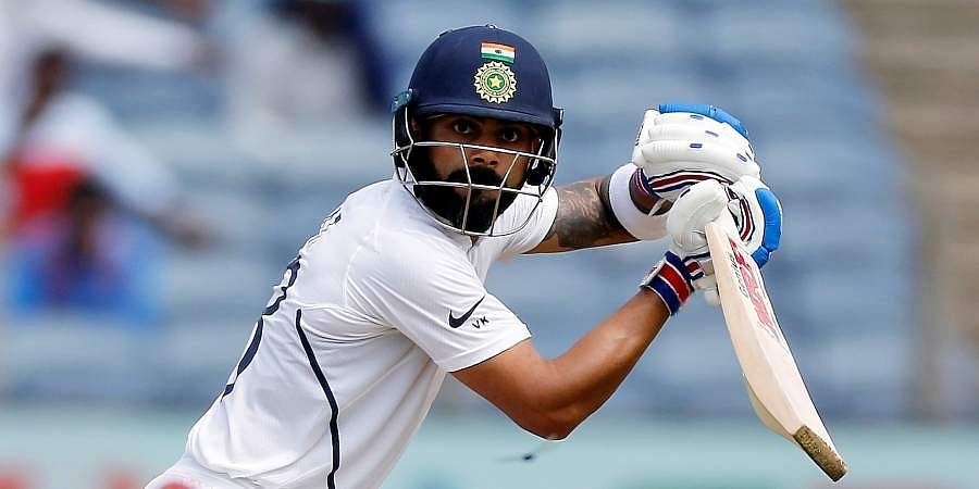 Virat Kohli bats during the second day of the cricket test match between India and South Africa in Pune.