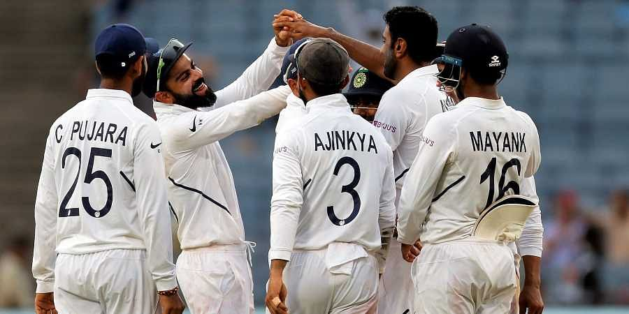 Virat Kohli celebrates with teammates after the dismissal of Keshav Maharaj during the third day of the second cricket Test match between India and South Africa in Pune.