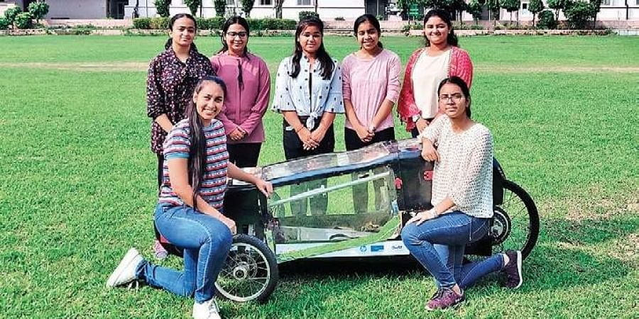 The team of engineering students from IGDTUW with their prototype car.