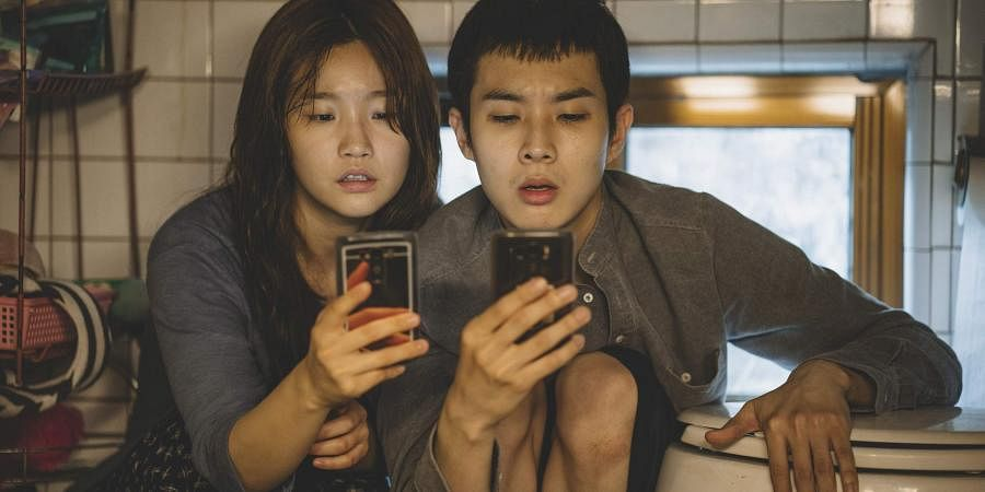 This image released by Neon shows So-dam Park, left, and Woo-sik Choi in a scene from 'Parasite.' (Photo | AP)