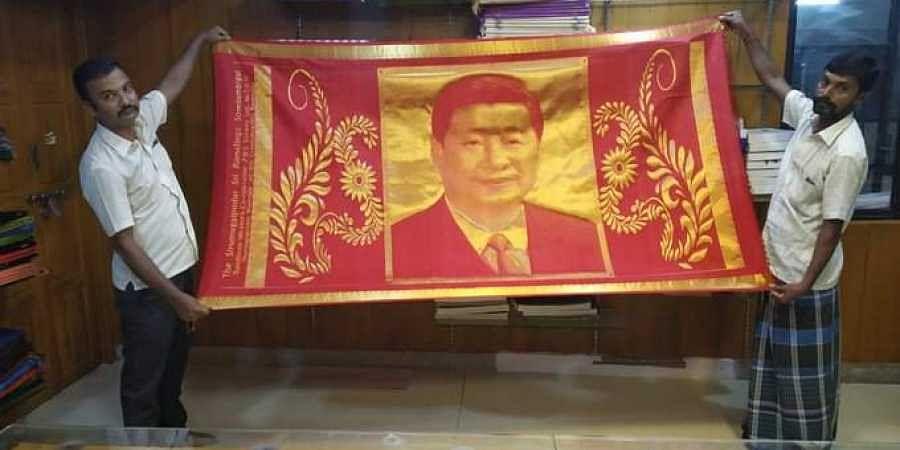 Designer M Dharmaraj and weavers A Shanmugasundaram and E Manoj Kumar in Sirumugai were behind the shawl Modi gave to  Xi