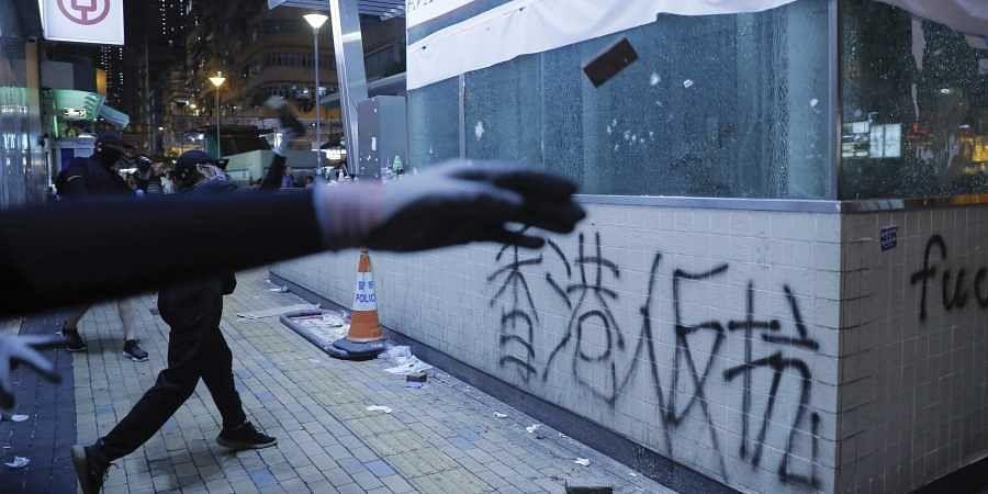 Protestors vandalize a subway entrance in Hong Kong