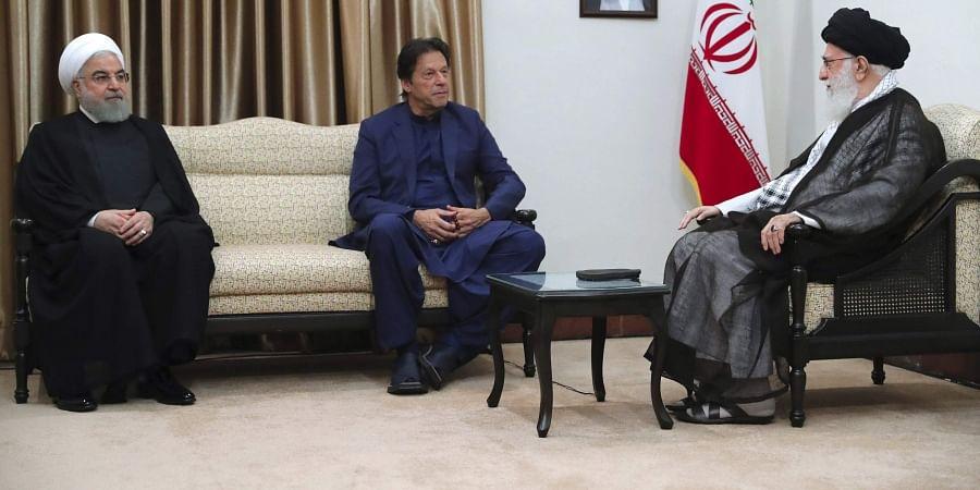 Iranian Supreme Leader Ayatollah Ali Khamenei (R) meets Pakistani Prime Minister Imran Khan (C)  with Iranian President Hassan Rouhani in Tehran