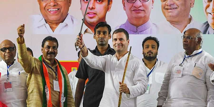 Former Congress president Rahul Gandhi holds a sword at a joint Congress-NCP rally ahead of Maharashtra Asembly elections in Mumbai Sunday Oct. 13 2019.   (Photo   PTI)