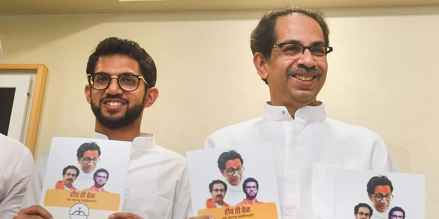 Shiv Sena President Uddhav Thackeray along with Yuva Sena chief Aditya Thackeray release the manifesto for assembly elections in Mumbai.