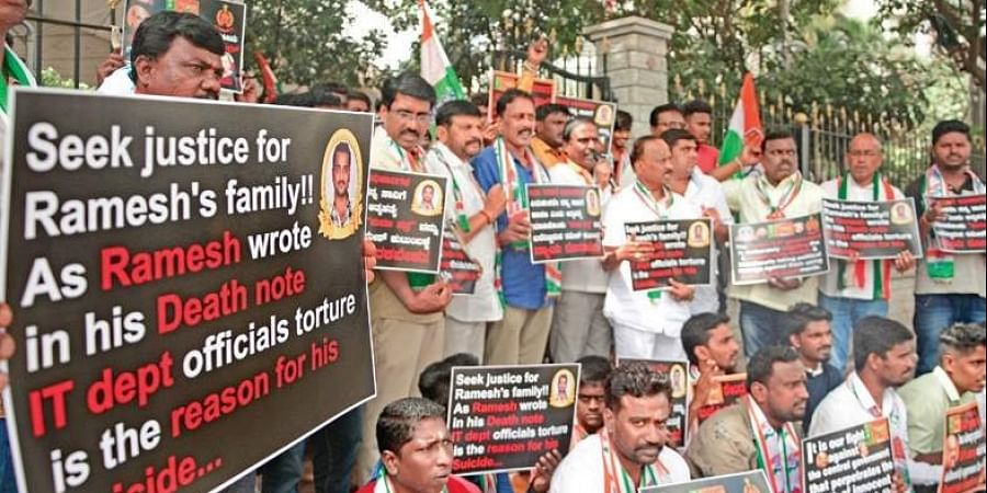 Members of Bengaluru City Youth Congress protest against the Centre, alleging that it is misusing IT, ED and CBI, and seeking justice for Ramesh who committed suicide after questioning by I-T officials, at Anand Rao Circle in Bengaluru on Sunday.