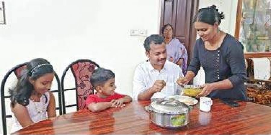 V K Prasanth having breakfast with his family before setting out for electioneering on Sunday. His wife Raji M R, son Aryan and daughter Aaliya can be seen.