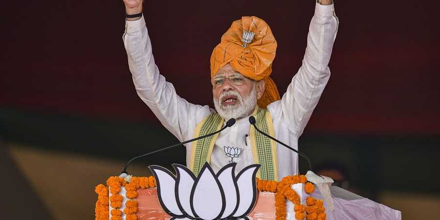 Prime Minister Narendra Modi addresses an election campaign rally for upcoming Haryana Assembly polls at Ballabgarh in Faridabad district Monday Oct. 14 2019. | (Photo | PTI)