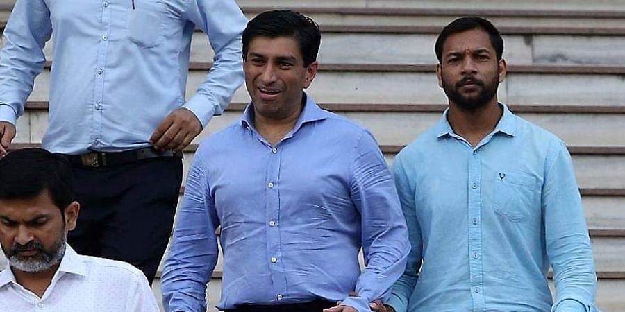 Madhya Pradesh CM Kamal Nath's nephew Ratul Puri (centre) leaves Enforcement Directorate office after being arrested in connection with a Rs 354 crore bank loan fraud case in New Delhi.