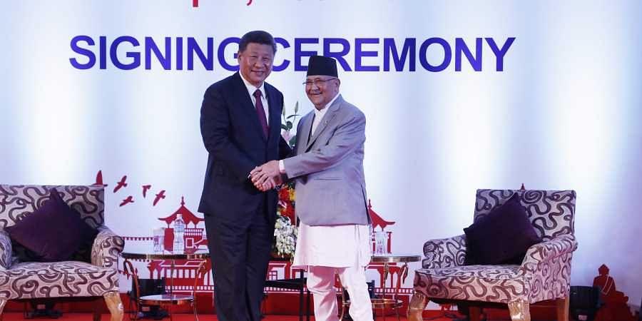 Chinese President Xi Jinping left and Nepalese Prime Minister Khadga Prasad Oli greet during their bilateral meeting in Kathmandu.