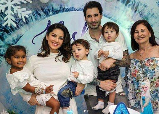 La Familia: Sunny Leone, husband Daniel Weber and their children pose for a family photo at Nisha's birthday celebration.