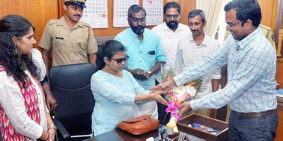 District collector K Gopalakrishnan welcoming the newly appointed sub-collector Pranjal Patil
