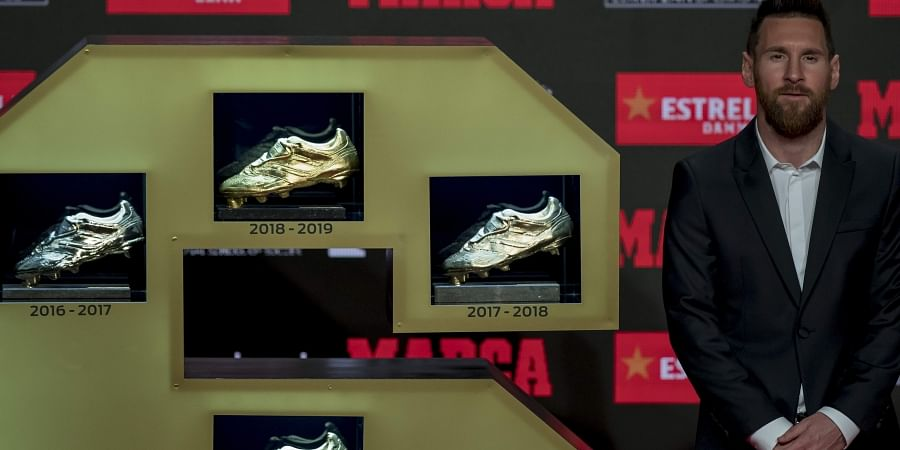Barcelona's Lionel Messi poses for the media after receiving his 6th Golden Boot award in Barcelona, Spain.