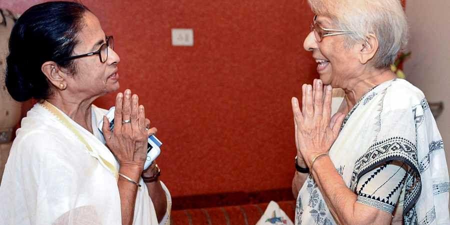 West Bengal Chief Minister Mamata Banerjee exchanges greetings with Nirmala Banerjee mother of Indian-American Nobel Prize winning economist Abhijit Banerjee in Kolkata Wednesday Oct. 16 2019. | (Photo | PTI)
