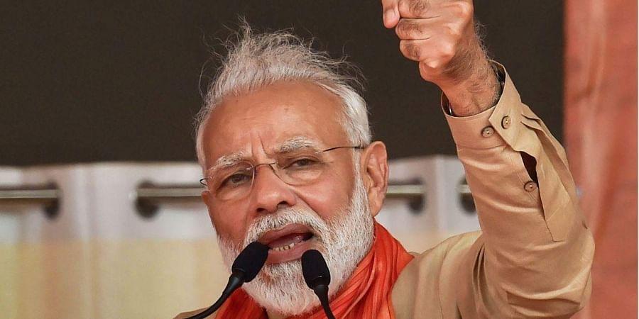 PM Narendra Modi addresses an election campaign rally in Haryana's Charkhi Dadri