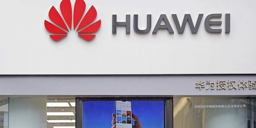 The logo of Huawei is displayed at a shop in China