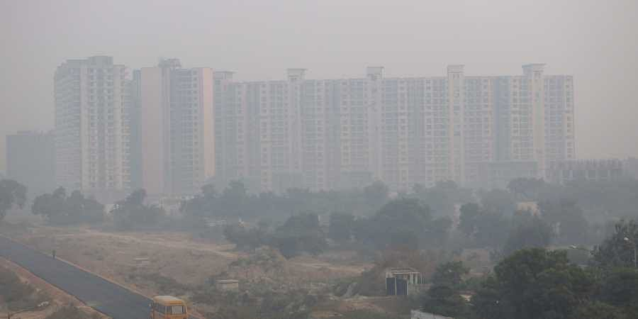 Under-construction high rise buildings are seen during a hazy morning in New Delhi on Tuesday.