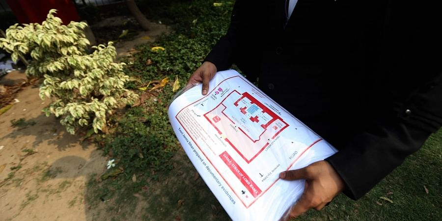 A lawyer holds a map calmed to be original site of Ram Janam Bhumi that was tore during Ram janmbhumi-Babri Masjid Case at Supreme Court