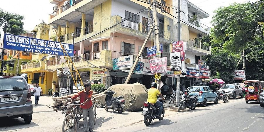 The unorganised mushrooming of shops and vendors has overtaken entire pavements and walking tracks made for the residents.