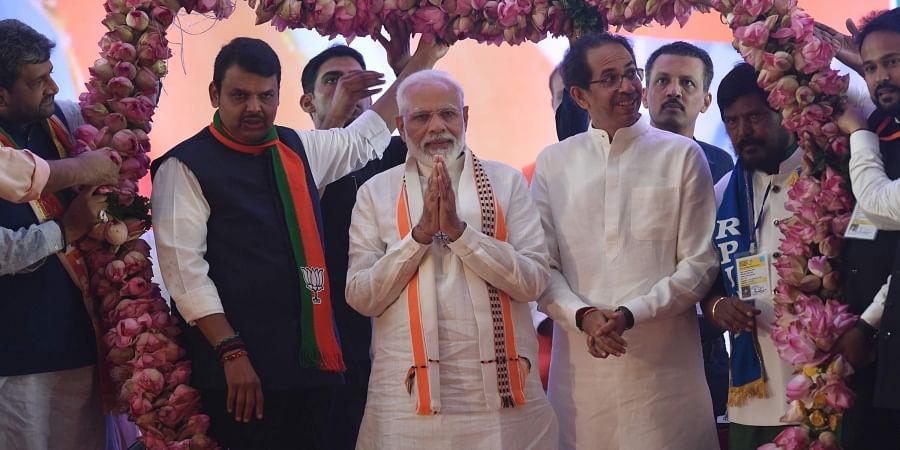 Prime Minister Narendra Modi along with Maharashtra CM Devendra Fadnavis Shiv Sena president Uddhhav Thackeray and RPI leader Ramdas Athawale being garlanded during an election rally ahead of Maharashtra Assembly elections in Mumbai Friday Oct. 18 2019. | (Photo | PTI)