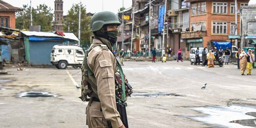 A security personnel stands guard during restrictions in Srinagar Friday Oct. 18 2019. | (Photo | PTI)