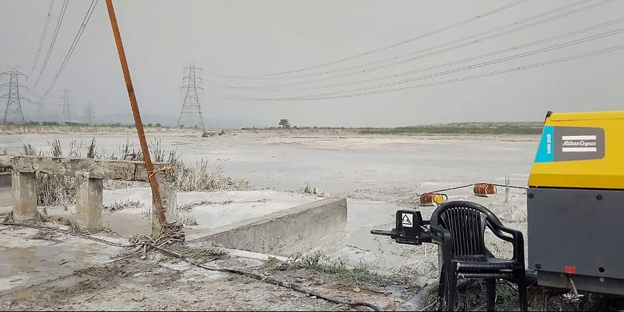 Ash and toxic residue leak due to a breach in an artificial pond at coal power plant run by public sector National Thermal Power Corporation NTPC in Singrauli Monday Oct. 7 2019. | (Photo | PTI)