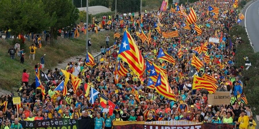 Pro independence protesters march in San Vicenc dels Horts. (Photo | AFP)