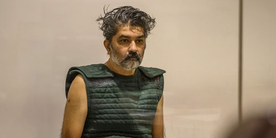 Shankar Hangud, wearing a personal safety vest, appears in the Placer County Superior Court.