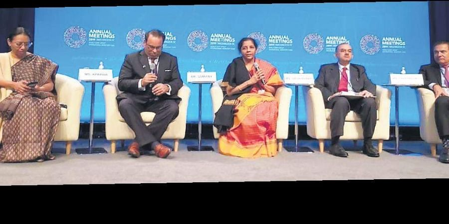 Union Finance Minister Nirmala Sitharaman (Centre) speaks to investors and US-based businessmen during her US tour.