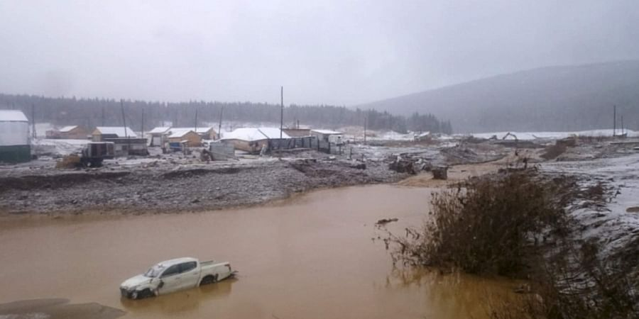 In this image made from video provided by Russian Emergency Situations Ministry press service, a view after the collapse during heavy rain occurred early Saturday near the village of Shchetinkino, in the Krasnoyarsk region about 3,400 Km (2,100 miles) east of Moscow, Russia, Saturday, Oct. 19, 2019.