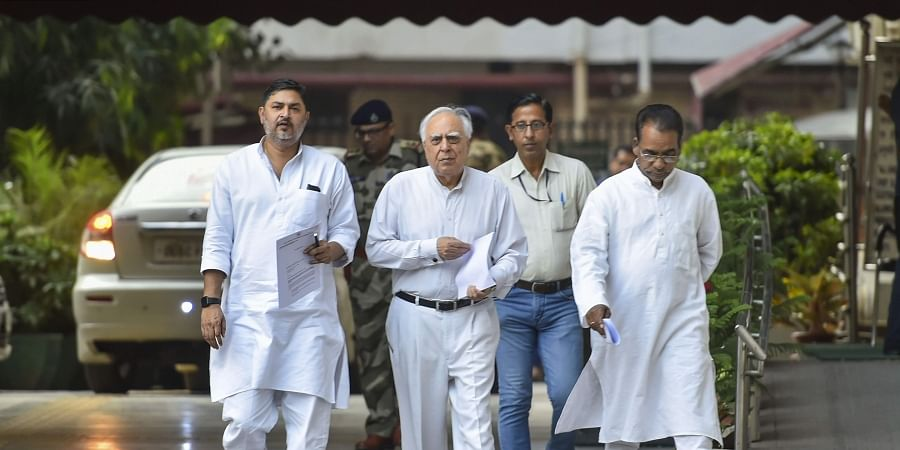 Senior Congress leader Kapil Sibal and other party leaders come out after meeting with Election Commission in New Delhi Friday Oct. 18 2019. | (Photo | PTI)