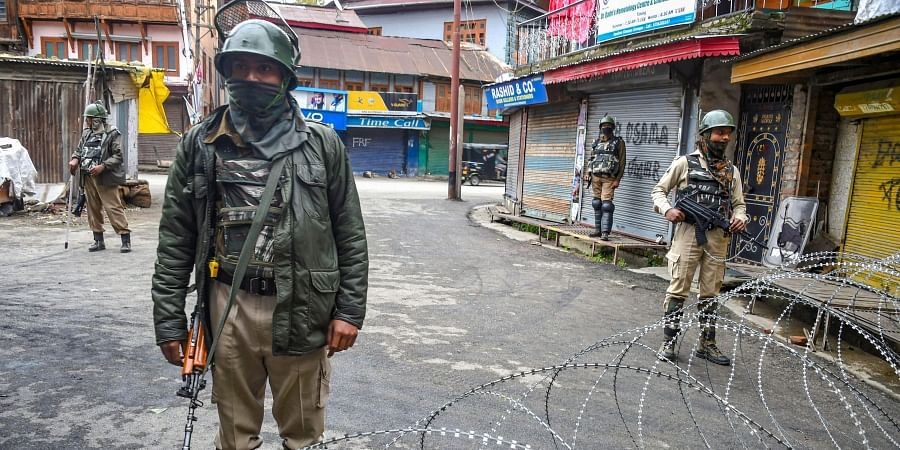 Security personnel stand guard during restrictions in Srinagar. (Photo | PTI)