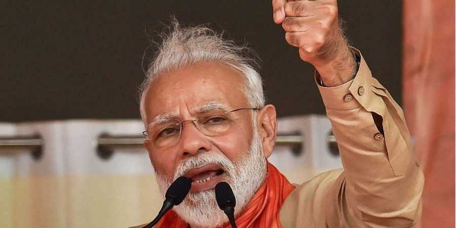 Prime Minister Narendra Modi gestures as he speaks during an election campaign rally in Hisar district of Haryana.