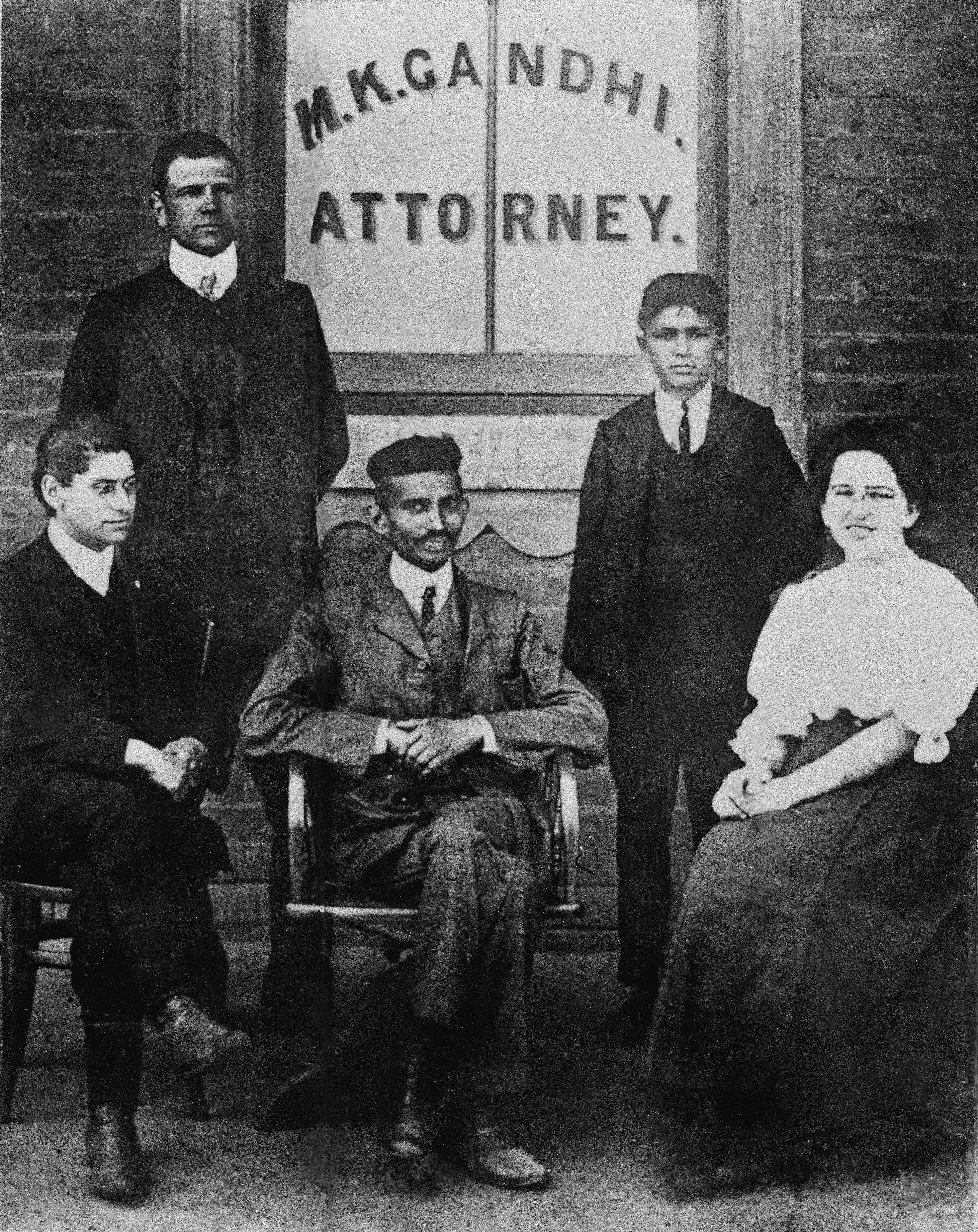 This 1906 photograph captures MK Gandhi with his secretary, Sonja Schlesin, Henry Soloman, Leon Polak and others in front of his office in Johannesburg.