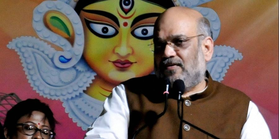 Union Home Minister Amit Shah addresses at the inauguration of a community puja pandal for Durga Puja in Kolkata Tuesday Oct. 1 2019. | (Photo | PTI)
