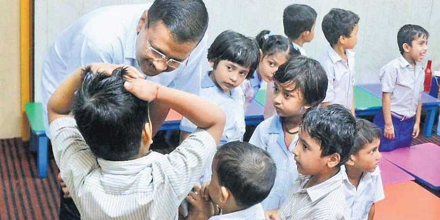 Chief Minister Arvind Kejriwal interacts with schoolchildren.