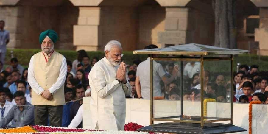 Prime minister Narendra modi pays tribute to Mahatma Gandhi on his 150th birth Anniversary at Rajghat in New Delhi on Wednesday. | (Photo | Shekhar Yadav/EPS)