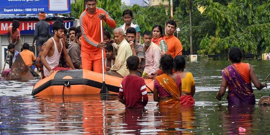Patna National Disaster Response Force NDRF workers rescue people from flood-affected Bahadurpur area after heavy rains in Patna Tuesday Oct. 01 2019.