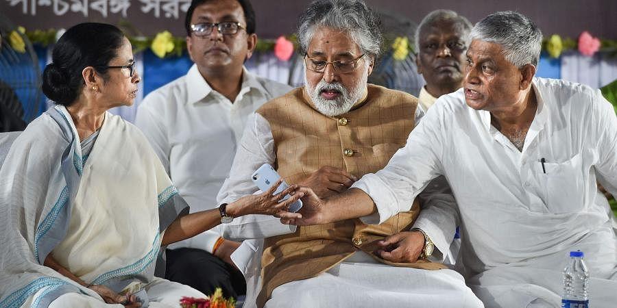 West Bengal Chief Minister Mamata Banerjee Congress MLA Abdul Mannan and TMC MP Sudip Bandyopadhyay during Mahatma Gandhi's 150th birth anniversary celebrations in Kolkata. (Photo | PTI)
